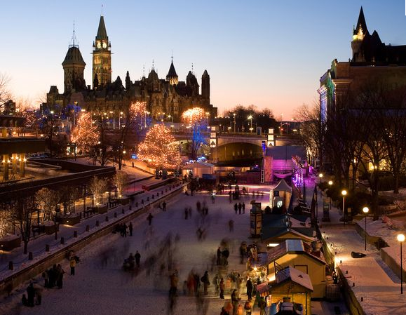 Ottawa. The frozen Rideau Canal - night view of the illuminated city - courtesy of Google Images