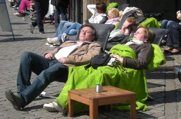 Copenhagen.  Outdoor cafes in the chilly weather - blankets provided.  - courtesy of Lars Gemzoe
