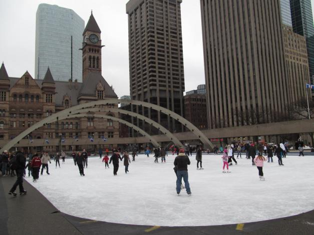 Toronto, Nathan Phillips Square.  Skating with views of the Old City Hall and downtown skyscrapers